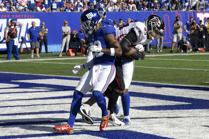Atlanta Falcons tight end Lee Smith (85) catches a touchdown pass during the second half of an NFL football game against the New York Giants, Sunday, Sept. 26, 2021, in East Rutherford, N.J. (AP Photo/Bill Kostroun)