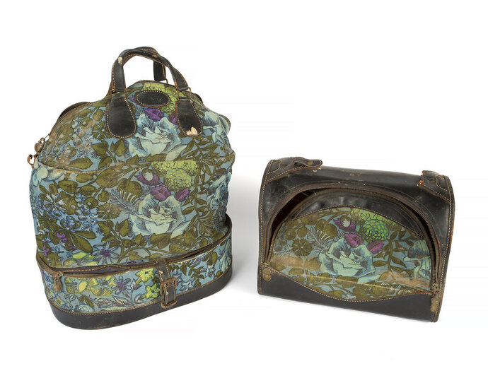 This combination photo shows two floral canvas and leather bags owned by the late actress Sharon Tate which will be auctioned November 17 in Los Angeles and online by Julien's Auctions. (Julien's Auctions via AP)