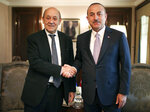 French Foreign Minister Jean-Yves Le Drian, left, and Turkey's Foreign Minister Mevlut Cavusoglu shake hands before a meeting in Ankara, Turkey, Thursday, June 13, 2019. (Turkish Foreign Ministry via AP, Pool)