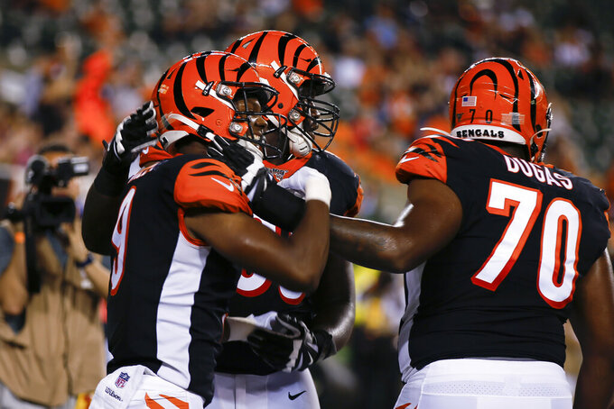 Cincinnati Bengals wide receiver Damion Willis, left, celebrates his touchdown with teammates during the second half of an NFL preseason football game against the New York Giants, Thursday, Aug. 22, 2019, in Cincinnati. (AP Photo/Gary Landers)