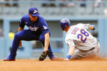 New York Mets' J.D. Davis, right, slides in to steal second base as Los Angeles Dodgers shortstop Corey Seager takes the throw during the fourth inning of a baseball game in Los Angeles, Saturday, Aug. 21, 2021. (AP Photo/Alex Gallardo)