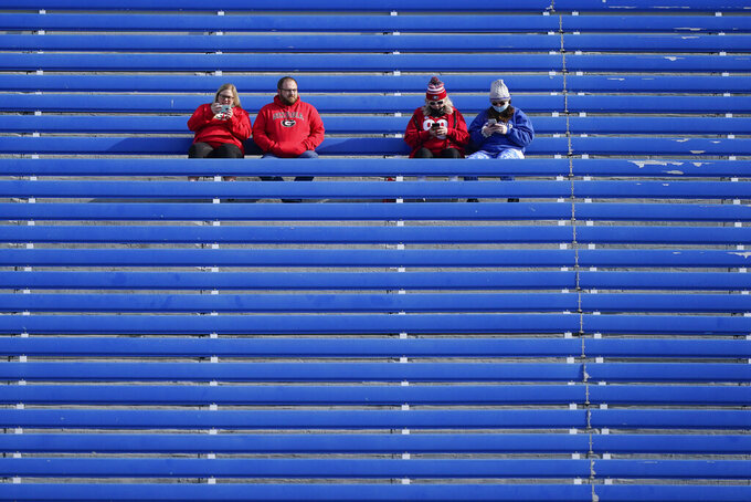 Georgia and Kentucky fans watch teams warm up before an NCAA college football game between Kentucky and Georgia, Saturday, Oct. 31, 2020, in Lexington, Ky. (AP Photo/Bryan Woolston)