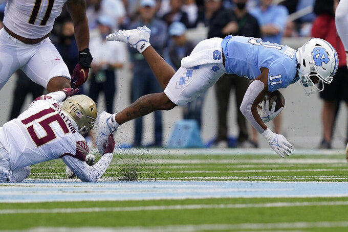 Florida State defensive back Jarques McClellion (15) tackles North Carolina wide receiver Josh Downs (11) during the first half of an NCAA college football game in Chapel Hill, N.C., Saturday, Oct. 9, 2021. (AP Photo/Gerry Broome)