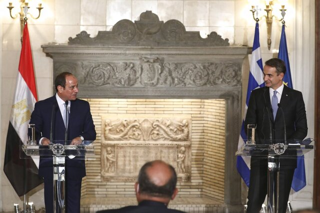 Greek Prime Minister Kyriakos Mitsotakis, right, and Egyptian President Abdel Fattah al-Sisi attend a joint news conference at Maximos Mansion in Athens, Wednesday, Nov. 11, 2020. Egypt's president is meeting with Greek officials in Athens on his first visit to the southern European nation since the two countries signed a deal demarcating maritime boundaries between them in the eastern Mediterranean. (Costas Baltas/Pool via AP)