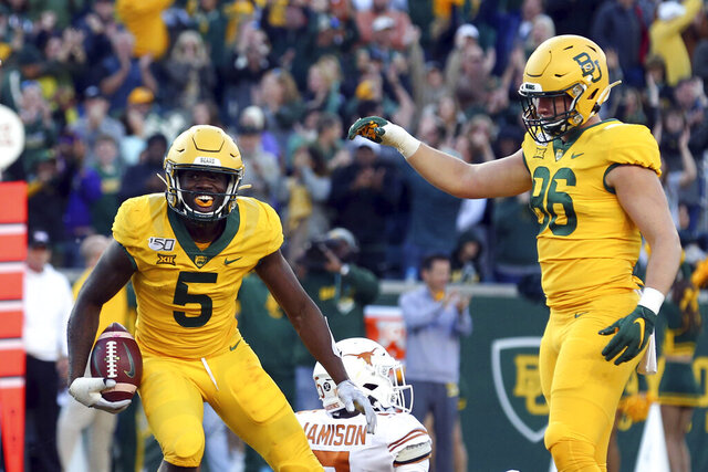 Baylor wide receiver Denzel Mims (5) and tight end Ben Sims (86) celebrate a third-quarter touchdown against Texas in an NCAA college football game Saturday, Nov. 23, 2019, in Waco, Texas. (AP Photo/Richard W. Rodriguez)