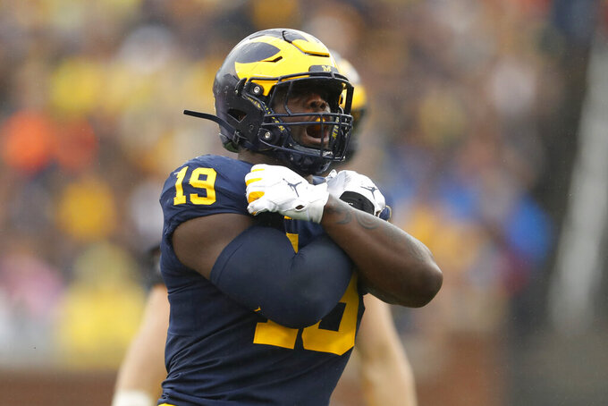 Michigan defensive lineman Kwity Paye reacts after sacking Rutgers quarterback Artur Sitkowski in the first half of an NCAA college football game in Ann Arbor, Mich., Saturday, Sept. 28, 2019. (AP Photo/Paul Sancya)