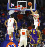 Florida guard Keyontae Johnson (11) catches the ball above the rim and slams it down after a pass from teammate Tre Mann (1) during an NCAA college basketball game against LSU, Wednesday, Feb. 26, 2020 in Gainesville, Fla.  (Brad McClenny/The Gainesville Sun via AP)