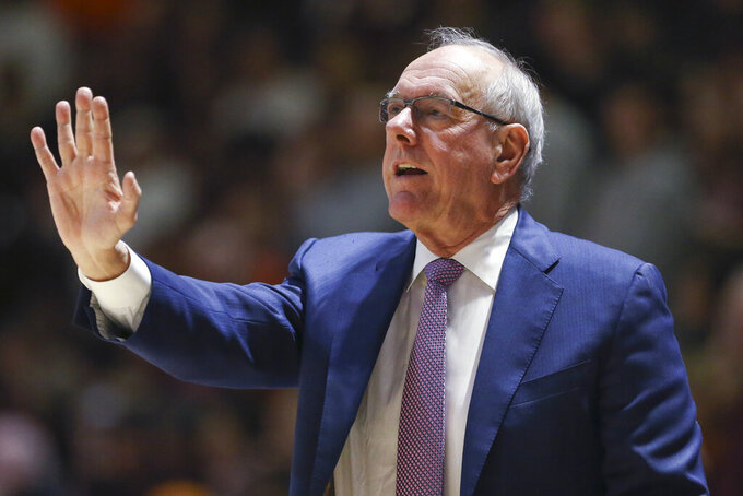 Syracuse coach Jim Boeheim signals his players from the bench during the first half of an NCAA college basketball game against Virginia Tech in Blacksburg, Va., Saturday, Jan. 26, 2019. (Matt Gentry/The Roanoke Times via AP)