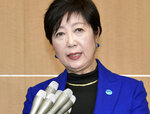 Tokyo Governor Yuriko Koike speaks to reporters after a meeting with the International Olympic Committee officials in Tokyo Wednesday, Oct. 30, 2019.  Tokyo Governor Koike has told powerful IOC members she wants the Olympic marathon held in Tokyo and lashed out at what she called an