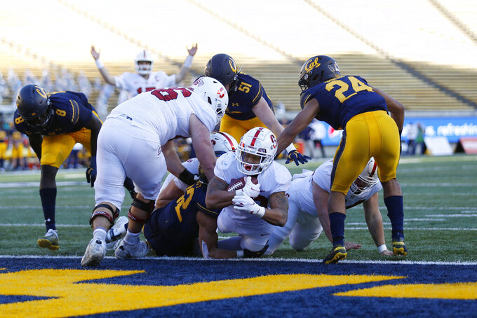 Stanford running back Austin Jones scores a touchdown against California during the second half of an NCAA college football game Friday, Nov. 27, 2020, in Berkeley, Calif. (AP Photo/Jed Jacobsohn)