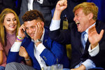 FILE - In this April 27, 2017, file photo, from left, Randi Martin, Patrick Mahomes and Leigh Steinberg react while Mahomes is on a call with the Kansas City Chiefs, during an NFL football draft watch party in Tyler, Texas. A decade after his personal and professional life bottomed out, agent Leigh Steinberg has returned to the top of his game, representing yet another Super Bowl MVP quarterback, Patrick Mahomes, and seeing another former client, Edgerrin James, be elected to the Hall of Fame. (Chelsea Purgahn/Tyler Morning Telegraph via AP, File)