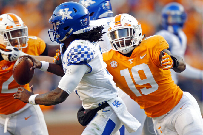 FILE - In this Nov. 10, 2018, file photo, Kentucky quarterback Terry Wilson (3) is pressured by Tennessee linebacker Darrell Taylor (19) in the first half of an NCAA college football game in Knoxville, Tenn. Darrell Taylor is coming off a breakthrough season but believes he's capable of doing even better. Taylor recorded eight sacks last year, the most of any Southeastern Conference player who's back this fall. (AP Photo/Wade Payne, File)