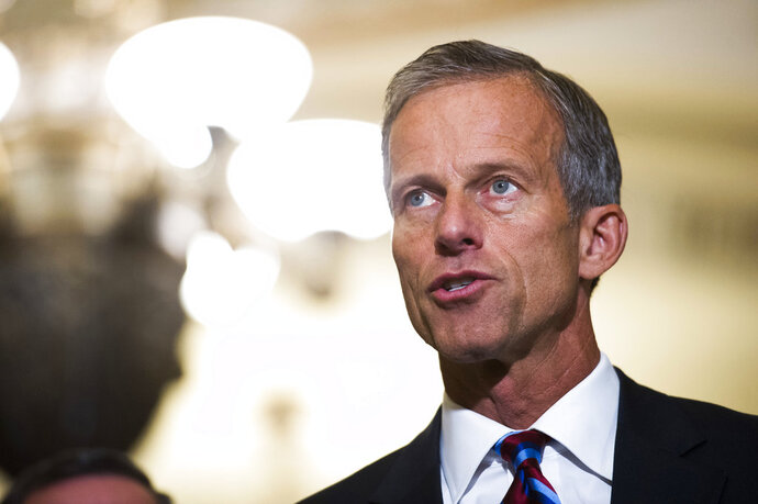 FILE - In this Sept. 5, 2018, file photo, Sen. John Thune, R-S.D., speaks with reporters after the Republican's policy luncheon on Capitol Hill in Washington. The Trump administration is hoping Congress can come up with a new set of national rules governing how companies can use consumers' data that finds a balance between