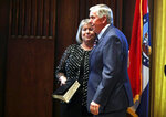 FILE - In this June 1, 2018 file photo, Gov. Mike Parson, right, smiles along side his wife, Teresa, after being sworn in as Missouri's 57th governor in Jefferson City, Mo. Teresa Parson has tested positive for the coronavirus after experiencing mild symptoms, a spokeswoman for the governor said Wednesday, Sept. 23, 2020.  (AP Photo/Jeff Roberson, File)