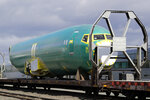FILE - In this April 9, 2019, file photo a Boeing 737 fuselage, eventually bound for Boeing's production facility in nearby Renton, Wash., sits on a flatcar rail car at a rail yard in Seattle. Boeing Co. reports earnings Wednesday, April 24. (AP Photo/Elaine Thompson, File)