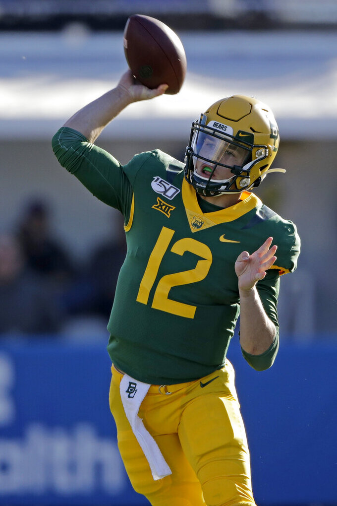 Baylor quarterback Charlie Brewer throws the ball during the first half of an NCAA college football game against Kansas, Saturday, Nov. 30, 2019, in Lawrence, Kan. (AP Photo/Charlie Riedel)