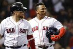 Boston Red Sox's Rafael Devers, right, walks off with Christian Vazquez as they watch a replay of Devers being called out at the plate trying to score during the ninth inning of the team's baseball game against the Minnesota Twins at Fenway Park, Thursday, Sept. 5, 2019, in Boston. The Twins won 2-1. (AP Photo/Elise Amendola)