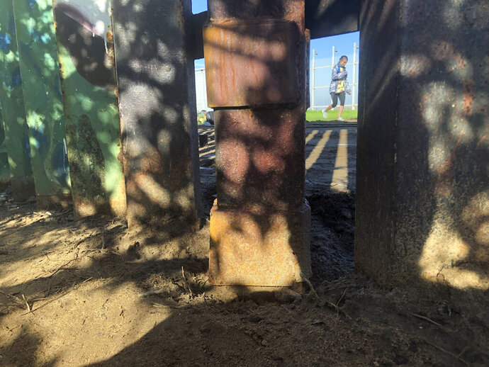 Smugglers allegedly cut a roughly 18-inch (1.2-meter) opening in the steel-pole of a border wall, since repaired, a breach that the U.S. Border Patrol said led to the