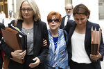 Madeline Sayoc, center, mother of Cesar Sayoc, leaves federal court with public defenders Amy Gallicchio, left, and Sarah Baumgartel, Monday, Aug. 5, 2019 in New York. Cesar Sayoc, a Florida amateur body builder who admitted sending inoperative pipe bombs to prominent Democrats and CNN, was sentenced to 20 years in prison Monday by a judge who said he concluded that the bombs purposely were not designed to explode. (AP Photo/Mark Lennihan)