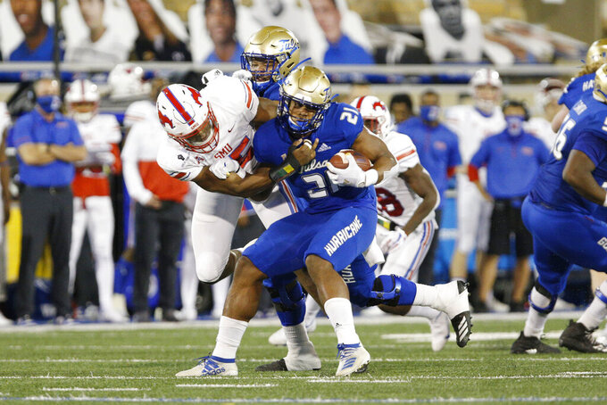 SMU defensive end Gary Wiley (55) wraps up Tulsa running back T.K. Wilkerson (21) during the first half of an NCAA college football game in Tulsa, Okla., Saturday, Nov. 14, 2020. (AP Photo/Joey Johnson)