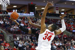 Rutgers' Shaq Carter, left, shoots past Ohio State's Kaleb Wesson during the first half of an NCAA college basketball game Wednesday, Feb. 12, 2020, in Columbus, Ohio. (AP Photo/Jay LaPrete)