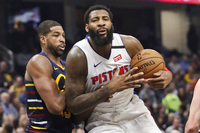 Detroit Pistons' Andre Drummond, right, drives against Cleveland Cavaliers' Tristan Thompson in the second half of an NBA basketball game, Tuesday, Jan. 7, 2020, in Cleveland. Detroit won 115-113.(AP Photo/Tony Dejak)