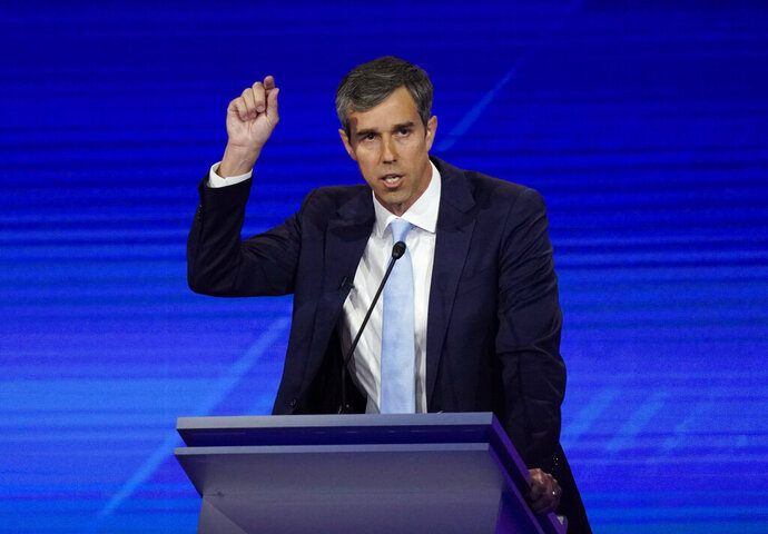 FILE - In this Thursday, Sept. 12, 2019 file photo, former Texas Rep. Beto O'Rourke responds to a question during a Democratic presidential primary debate in Houston. On Friday, Sept. 20, 2019, The Associated Press reported on stories circulating online incorrectly asserting that O'Rourke is a convicted felon who can't own a gun, and while campaigning for president has said he will send men house-to-house to take away guns. The presidential candidate has not been convicted of felony crimes, nor has he faced felony charges. He did not call for house-to-house confiscation of guns, but he has said he would act to take assault-type weapons from the general public through a mandatory buyback program. (AP Photo/David J. Phillip)