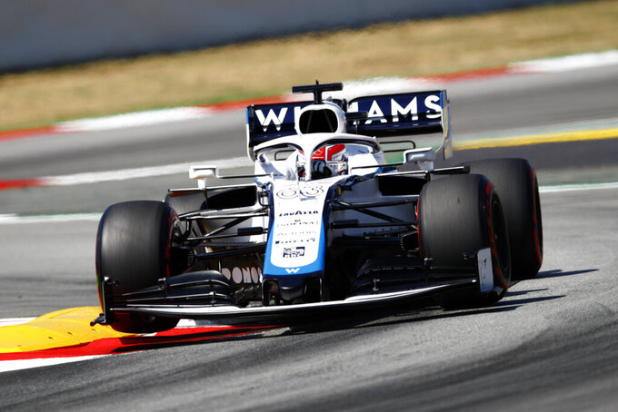 Williams driver George Russell of Britain steers his car during a practice session prior to the Formula One Grand Prix at the Barcelona Catalunya racetrack in Montmelo, Spain, Saturday, Aug. 15, 2020. (Alejandro Garcia, Pool via AP)