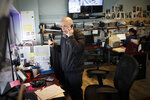 Pat Marmo, owner of Daniel J. Schaefer Funeral Home, speaks on two phones at once in his office while handling the overflow of clients stemming from COVID-19 deaths, Thursday, April 2, 2020, in the Brooklyn borough of New York. Like many funeral homes in New York and around the globe, Marmo's business is in crisis. His office phone and two mobiles are ringing constantly. He's apologizing to families at the start of every conversation for being unusually terse and insensitive, and begging them to insist hospitals hold their loved ones as long as possible. (AP Photo/John Minchillo)