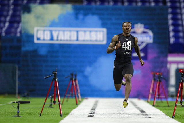 Alabama wide receiver Henry Ruggs III runs the 40-yard dash at the NFL football scouting combine in Indianapolis, Thursday, Feb. 27, 2020. (AP Photo/Michael Conroy)
