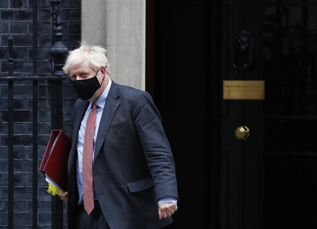 Britain's Prime Minister Boris Johnson leaves 10 Downing Street for the House of Commons to attend his weekly Prime Minister's Questions in London, Wednesday, Sept. 30, 2020. (AP Photo/Alastair Grant)