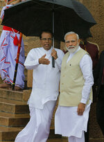 Indian Prime Minister Narendra Modi, right is received by the Sri Lankan President Maithripala Sirisena, left, upon his arrival at the presidential secretariat in Colombo, Sri Lanka, Sunday, June 9, 2019. Modi arrived in Sri Lanka on Sunday for a brief visit as part of his first overseas tour since reelection that emphasizes India's