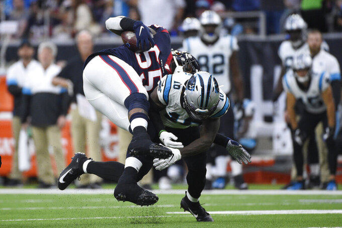 Houston Texans inside linebacker Benardrick McKinney (55) is hit by Carolina Panthers wide receiver Curtis Samuel (10) after he recovered a fumble during the first half of an NFL football game Sunday, Sept. 29, 2019, in Houston. (AP Photo/Eric Christian Smith)