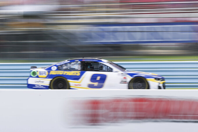 Chase Elliott drives by the grandstand near the finish line during a NASCAR Cup Series auto race in Watkins Glen, N.Y., on Sunday, Aug. 8, 2021. (AP Photo/Joshua Bessex)