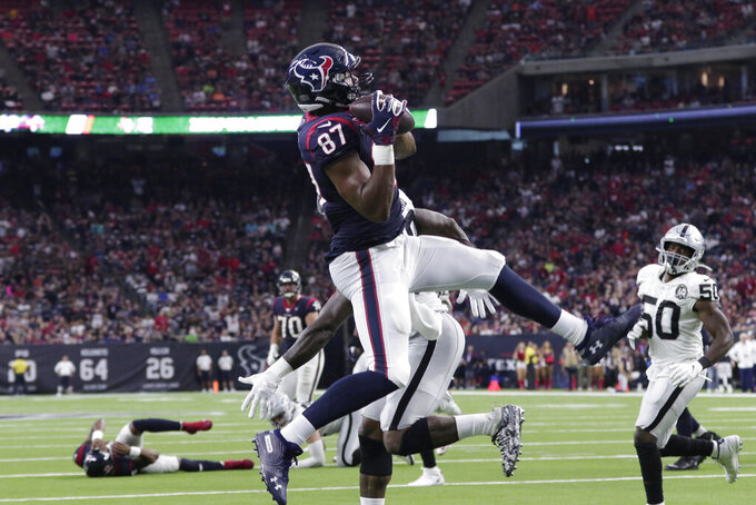 Houston Texans tight end Darren Fells (87) catches a pass for a touchdown against the Oakland Raiders during the second half of an NFL football game Sunday, Oct. 27, 2019, in Houston. (AP Photo/Michael Wyke)