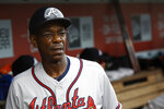FILE - In this July 31, 2019, file photo, Atlanta Braves third base coach Ron Washington walks in the dugout during a baseball game against the Washington Nationals in Washington. Coach Washington is the winningest manager for the Rangers, and led them to their only two World Series appearances in 2010 and 2011. Washington, Atlanta's third base coach since 2017, would have been back in Texas for a three-game interleague series, though in different ballpark than the one where he managed. Washington was near the end of his eighth season with Texas in 2014 when he stepped down for personal reasons. (AP Photo/Patrick Semansky, File)