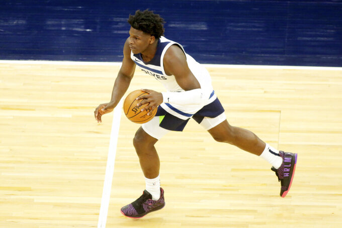 Minnesota Timberwolves guard Anthony Edwards moves the ball against the Memphis Grizzlies in the third quarter during an NBA preseason basketball game, Saturday, Dec. 12, 2020, in Minneapolis. (AP Photo/Andy Clayton- King)