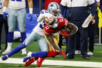 San Francisco 49ers' Brandon Aiyuk (11) is tackled by Dallas Cowboys' Anthony Brown (30) after catching a pass in the second half of an NFL football game in Arlington, Texas, Sunday, Dec. 20, 2020. Cowboys head coach Mike McCarthy, right rear, looks on at the play. (AP Photo/Michael Ainsworth)