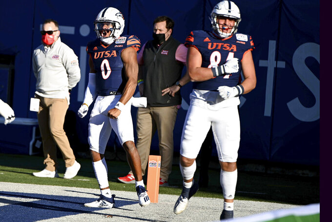 UTSA quarterback Frank Harris (0) celebrates his rushing touchdown with teammate Oscar Cardenas (84) in the second quarter during the First Responder Bowl NCAA college football game against Louisiana-Lafayette in Dallas, Saturday, Dec. 26, 2020. (AP Photo/Matt Strasen)