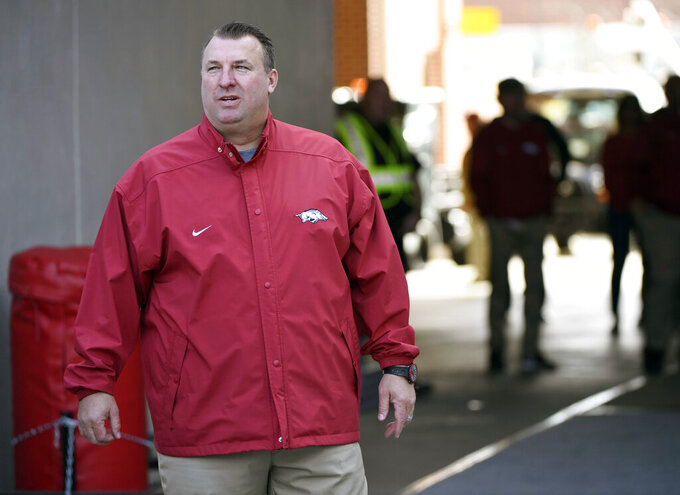 FILE - In this Friday, Nov. 24, 2017 file photo, Arkansas coach Bret Bielema gets choked up as the senior players are introduced before the start of an NCAA college football game in Fayetteville, Ark. It's going on 40 days since Bret Bielema was announced as Illinois' football coach, and since then he's assembled a staff, met returning players, recruited new ones, convinced a top player to pull his name out of the transfer portal and made the rounds getting to know administrators and alumni. (AP Photo/Michael Woods, File)