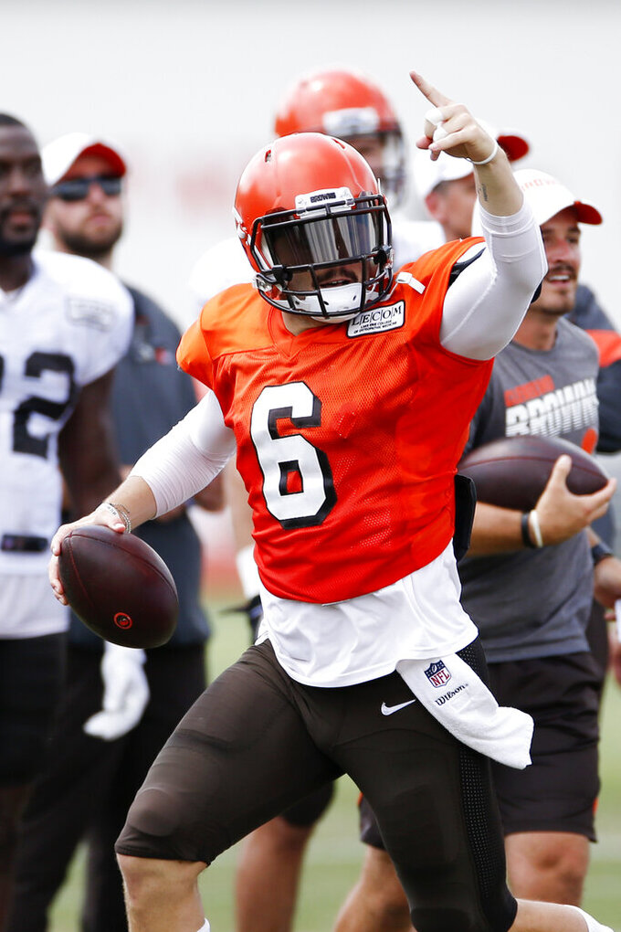 Cleveland Browns quarterback Baker Mayfield (6) looks to pass during practice at the NFL football team's training facility Monday, Aug. 5, 2019, in Berea, Ohio. (AP Photo/Ron Schwane)