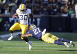 Pittsburgh running back Qadree Ollison (30) is tackled by Notre Dame cornerback Julian Love during the second half of an NCAA college football game, Saturday, Oct. 13, 2018, in South Bend, Ind. Notre Dame won 19-14. (AP Photo/Darron Cummings)