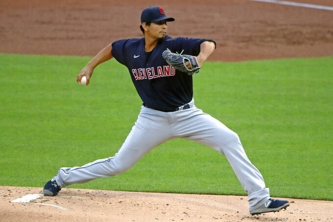 FILE - Cleveland Indians starting pitcher Carlos Carrasco delivers during the first inning of a baseball game against the Pittsburgh Pirates in Pittsburgh, Tuesday, Aug. 18, 2020. The Cleveland Indians have agreed to trade four-time All-Star shortstop Francisco Lindor and pitcher Carlos Carrasco to the New York Mets, a person with direct knowledge of the deal told the Associated Press on Thursday, Jan. 7, 2021. (AP Photo/Gene J. Puskar, FIle)