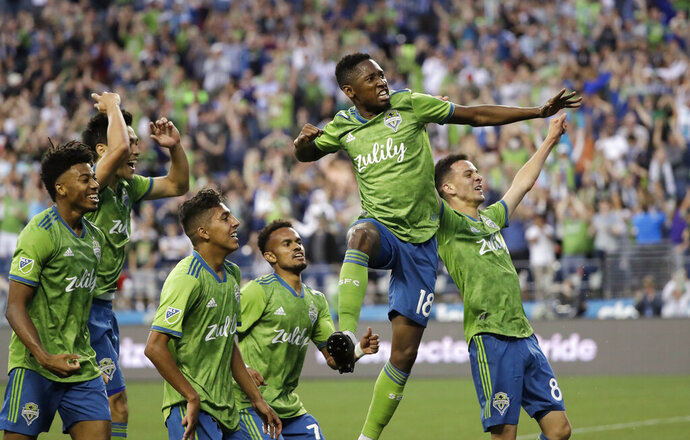 Seattle Sounders' Kelvin Leerdam (18) leaps and pumps his fist after scoring against the Vancouver Whitecaps late in the second half of an MLS soccer match Saturday, June 29, 2019, in Seattle. The Sounders won 1-0. (AP Photo/Elaine Thompson)