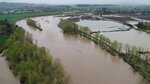 In this Monday, April 8, 2019 photo made with a drone, the Santiam River flows over its banks and into neighboring fields just east of Interstate 5 as the river reached moderate flood stage Monday afternoon following several days of heavy rain. (Kelly Jordan and Zach Urness/Statesman-Journal via AP)
