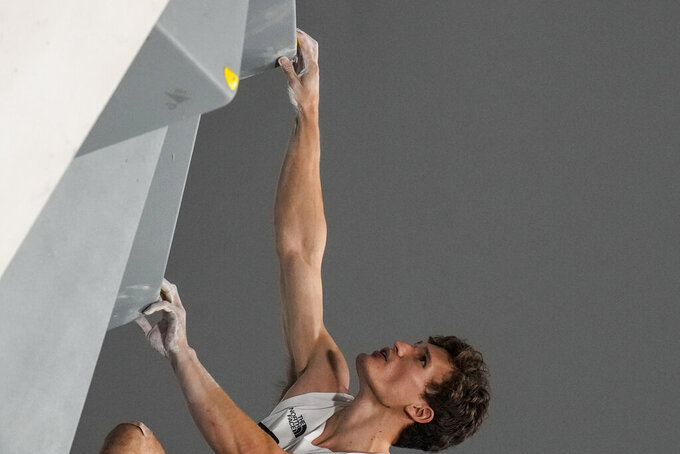 Nathaniel Coleman, of the United States, competes during the bouldering portion of the men's sport climbing final at the 2020 Summer Olympics, Thursday, Aug. 5, 2021, in Tokyo, Japan. (AP Photo/Gregory Bull)