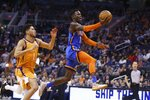 Oklahoma City Thunder guard Dennis Schroeder (17) drives past Phoenix Suns guard Devin Booker (1) during the first half of an NBA basketball game Friday, Jan. 31, 2020, in Phoenix. (AP Photo/Ross D. Franklin)