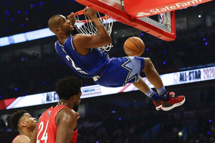 Chris Paul of the Oklahoma City Thunder dunks during the first half of the NBA All-Star basketball game Sunday, Feb. 16, 2020, in Chicago. (AP Photo/Nam Huh)