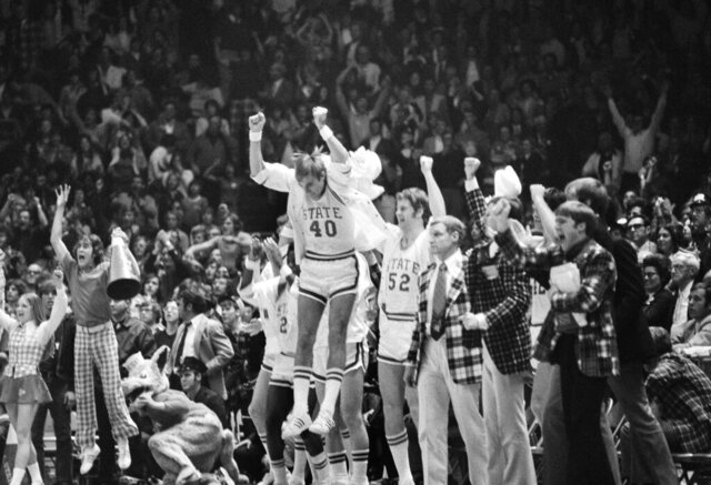 FILE - In this March 23, 1974, file photo, North Carolina State's Mark Noeller (40) jumps into the air as they defeat UCLA 80-77 in double overtime in a semifinal game at the NCAA college basketball championships in Greensboro, N.C. (AP Photo/File)
