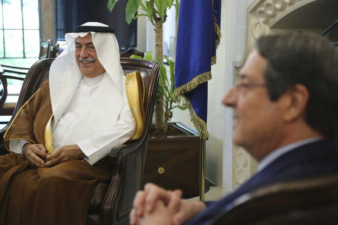 Cyprus' president Nicos Anastasiades, right, and Saudi Foreign Minister Ibrahim Bin Abdulaziz Al-Assaf talk during their meeting at the presidential palace in capital Nicosia, Cyprus, Wednesday Sept. 11, 2019. (AP Photo/Petros Karadjias)